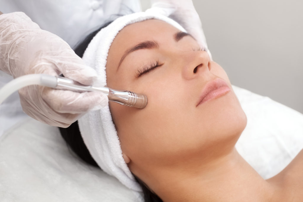 Young woman having a cosmetic dermatology procedure performed on her facial area